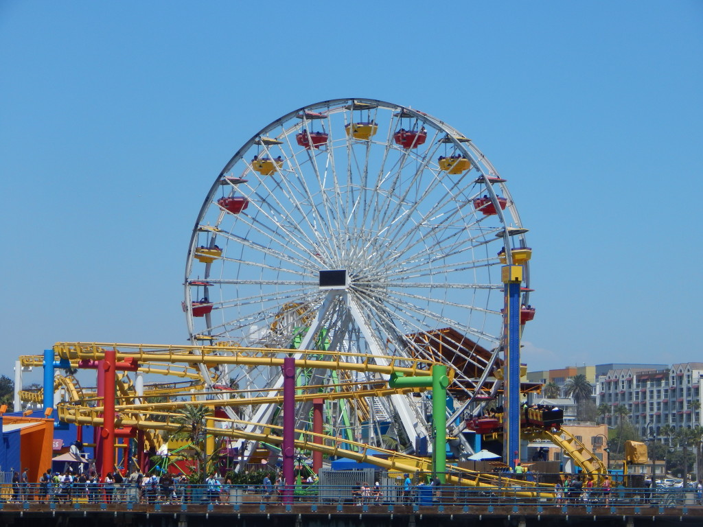 """Santa Monica Pier Ferris Wheel"" by Laura Choate - Own work. Licensed under CC BY-SA 3.0 via Wikimedia Commons - http://commons.wikimedia.org/wiki/File:Santa_Monica_Pier_Ferris_Wheel.JPG#mediaviewer/File:Santa_Monica_Pier_Ferris_Wheel.JPG"